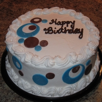 "Blue & Brown Offset Circles 9"" round covered in buttercream & fondant offset cirles and polka dots"