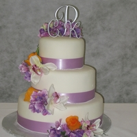 Purple And Orange Wedding Bride asked for a 3 tier cake with lavender ribbon and she provided the silk flowers which she wanted cascading down the side. It isn'...