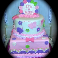 It's A Girl Butterflies, Buttons, And Bows Baby Shower Cake It's A Girl Butterflies, Buttons, and Bows Baby Shower Cake