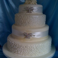 Wedding Cake my first wedding cake it was an order from a jewelry shop for the start of the sale the bottom 2 tiers are dummy cake the top 2 are sponge...