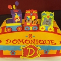 Carnival/circus Theme Cake Buttercream cake with fondant details. The train/animal carts were made from RKT.