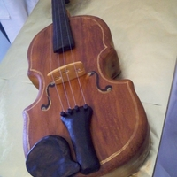 Violin Grooms Cake With this order I did both the grooms cake and the wedding cake. The groom is a violinist and the bride surprised him with this amazing...