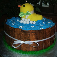 Another Duck In A Tub Cake! All edible except ribbon. Duck is shaped RKT which is my first & probably last time using. Cake is 12 inch round.
