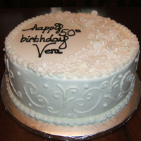Vera's 50Th Customer wanted all white decorations for a birthday cake. Flowers made from fondant. Buttercream on cake.