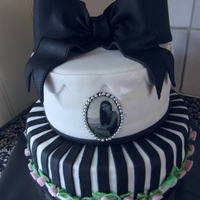 Black And White Birtdaycake black and white birthdaycake with a bow and a little photo