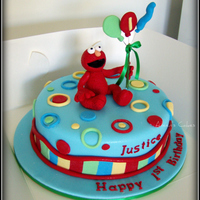 "Elmo With Balloons  9"" chocolate mud elmo cake with chocolate ganche filling and iced in fondant. Elmo and balloons are made from fondant with wire and..."