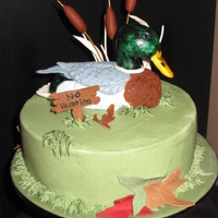 Just Ducky Marbeld cake with chocolat icing between the layers and buttercream outside. Mr. Mallard is all fondant.