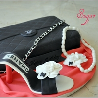 Chanel Bag Cake chanel bag cake with gumpaste shoes, everything is eddible except the chain!!