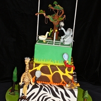 Wild About Tennis   Gumpaste animals playing tennis for a local tennis tournament benefitting a children's hospital.