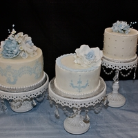 Ice Blue Bridal Shower Cakes Two lemon cakes with lemon custard filling and lemon buttercream and one chocolate cake with vanilla buttercream. Gumpaste peonies, roses...