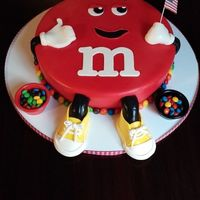 M&m Cake This is for my daughter's 22nd birthday. She wears converse all the time so I gave him yellow converse instead of white shoes. The...