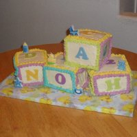 "Baby Shower For ""noah"" mini 3 layer white cakes, vanilla frostings, fondant hand cutout letters, the little ""toys"" are the candles"