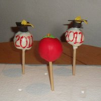 Happy Graduation Cake Pops Chocolate Cake/icing, dipped in white chocolate. Fondant decorations