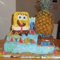 Spongebob Squarepants Cake Blue buttercream, Fondant decorations, real hollowed-out pineapple. Spongebob and Crabshack are crispie treat covered in fondant and hand...