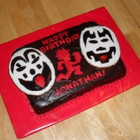 Insane Clown Possee Cake Chocolate cake, fudge icings. Clown faces are sugar cookies glazed with a frosting of powdered sugar & milk, then hand painted with...