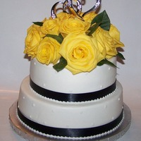 Fresh Rose Anniversary Cake 10in 8in stacked - iced in buttercream with navy satin ribbon and fresh yellow roses - this was my first time using fresh flowers - thanks...