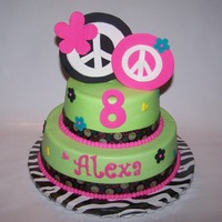 Stacked Peace Sign Cake! 9in 6in stacked round Peace Sign Cake! Iced in buttercream with fondant/gumpaste accents and ribbon border - thanks for looking! :-)