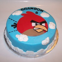Angry Bird! 10 in round - iced in buttercream with buttercream clouds - angry bird is fondant - thanks for looking!