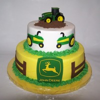 John Deere 9in 6in stacked John Deere Cake - iced in buttercream with fondant accents - the tractor and sign are not edible - thanks for all of the...