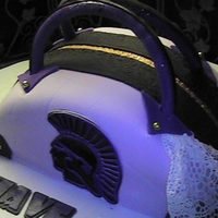 Purse Cake  My first purse cake. Indydebi buttercream made it delis, then covered in fondant. The decoration are Linda McClure's gumpaste and...