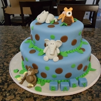 Animal Safari Baby Shower Cake Here is a 3 tier baby shower cake i made. I hand made the animal, i found a book on a clearance rack a long time ago and finally made use...