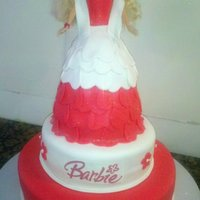 Tiered Birthday Barbie Girl Cake My first attempt at making a barbie cake. I had 2 hours to frost, cover, and stack the cake and make her dress. Didnt come out exactly as i...