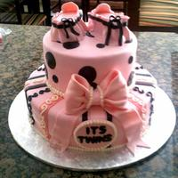 Pink Baby Shower Twin Tiered Cake *SOON TO BE MOM WAS SUPER HAPPY WITH HER CAKE. THE CRIBS ARE SMALL CUT PIECES OF CAKE COVERED IN FONDANT.