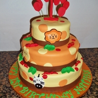 Safari Theme Tiered Birthday Cake Fondant covered birthday cake.