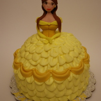 Princess Belle Belle is all fondant. Her dress is five layers of chocolate cake carved to the shape of her dress and then piped with buttercream and...