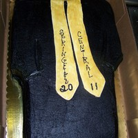 Graduation Gown Double full sheet cut out gown shape sprayed , with fondant scarf with name of school and year.