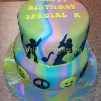 Disco Birthday   My SIL was having a 70s themed birthday and I made her a tie-dye cake with disco dancers on the outside,