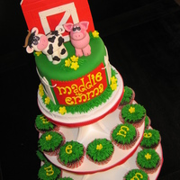 Barnyard Topper Cake & Cupcakes Barnyard Themed Cake & Cupcakes. Animals, barn & letters done with fondant, 'grass' was piped onto cupcakes & trim on...
