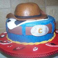 Cowboy Up! Chocolate cake with choc buttercream, chocolate wrapped before covering with fondant. Hand painted the jeans to get a more weathered look....