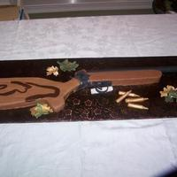 Rifle Cake Everything is edible but the barrel. Also made antlers and a camo hat but they dont show in the picture. This was a fun cake and my first...