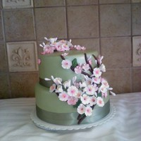 Cherry Blossoms In Bloom!  Chocolate and Lemon Doberge. Whipped chocolate icing covered with fondant. This cake was made for 90th Birthday party for a special family...