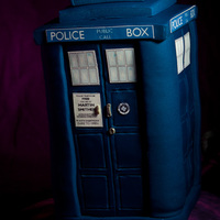 Dr Who Tardis Dr who Tardis is a chocolate mud cake with white chocolate buttercream filling.The base is an edible print of a vortex on a 12 inch drum...