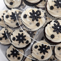 Black And Silver Cupcake Tower Cupcakes are a rich chocolate cake with a delicious white chocolate cream swirl.