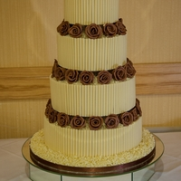 4 Tier Chocolate Wedding Cake 4 Tier all chocolate wedding cake. The cake sizes are 12, 10, 8, & 6 inches in diameter. Each cake has milk chocolate ganache running...