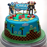 Sonic & Shadow Childrens Cake This cake is a chocolate mud cake, i baked 2 x 9 inch round cakes and stacked them to get the height. The cake has a chocolate hazelnut...