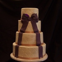 H & D   4 Tier, Fondant, Diamond Pattern with sugar pearls. Amethyst Bow