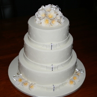 3 Tier Frangipani Cake   3 tier fruit cake with hand made frangipani flowers on top and bottom of cake