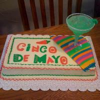 Cinco De Mayo Cake  Made for a company party last Cinco de Mayo. Margarita glass is plastic, filled with margarita flavored Jello, clear gelatin ice cubes, and...