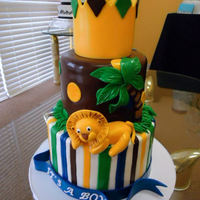 King Of The Jungle Baby Shower Cake *Two tier strawberry cake. The top tier is modeling chocolate with fondant decorations. The bottom tier is butter cream with fondant...