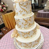 Gold Swirls And Peonies Buttercream cake with gold royal icing swirls and open peonies.