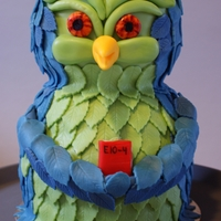 Owl Cake Chocolate mud cake filled with strawberry mousse and decorated with modeling chocolate.