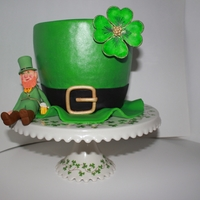 St. Patricks Day Elvis Presley whipping cream cake, filled with chocolate ganache and covered in fondant. Shamrock and leprechaun (my first) inspired by CC...