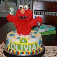 Olivia's 3Rd Birthday Elmo is made of rice krispies and chocolate. WASC filled with strawberry cream. Cake and decorations all fondant.