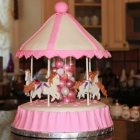 Victoria's Merry Go Round  Merry go round made for my granddaughters 4th birthday. Vanilla cake, with chocolate frosting. The center is a glass vase filled with...