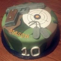 "Camo Pistol Cake  I was afraid I wouldn't get the camo pattern right, but I have one of those ""Mats"" and just started laying the camo out and..."