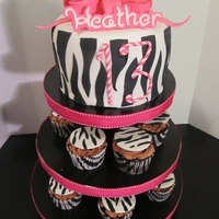 Pink Zebra This is a 6in cake on a homemade cupcake pedastal and 12 cupcakes.
